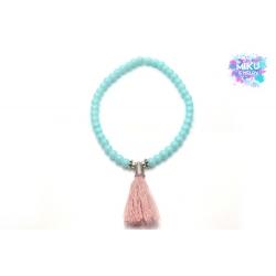 Türkisfarbenes Perlenarmband mit rosa Quaste